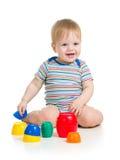 演奏玩具的小孩子 图库摄影