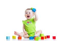 演奏玩具的愉快的儿童女孩被隔绝 库存照片