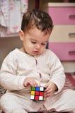 演奏玩具的男孩多维数据集 图库摄影