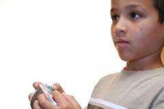 演奏视频年轻人的男孩比赛 免版税库存照片