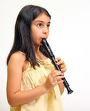 演奏记录员年轻人的女孩 库存图片