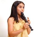 演奏记录员年轻人的女孩 免版税库存照片