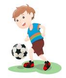 演奏足球动画片的男孩 库存图片