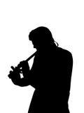 演奏长笛的剪影 库存照片