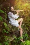 演奏长笛的树精在雨以后 库存照片