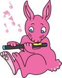 演奏长笛的桃红色兔子 免版税库存照片