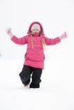 演奏雪的女孩 库存照片