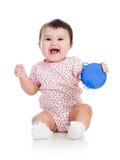 演奏音乐玩具的女婴 库存照片