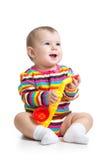 演奏音乐玩具的女婴 免版税库存照片