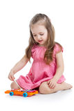 演奏音乐玩具的孩子女孩 免版税库存图片