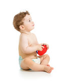 演奏音乐玩具的男婴 免版税库存图片
