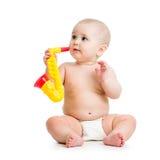 演奏音乐玩具的婴孩 免版税库存图片