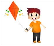 演奏风筝的小男孩 免版税库存照片