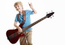 演奏年轻人的男孩逗人喜爱的电吉他 免版税图库摄影