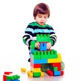 演奏lego的小俏丽的男孩 库存照片