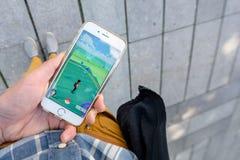 演奏Pokemon去比赛 免版税图库摄影