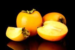 演播室射击了许多亚洲柿树切了黑色 免版税库存图片
