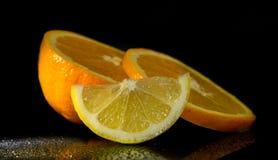 演播室射击用柠檬和桔子 免版税库存照片