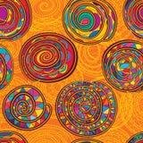 漩涡线橙黄五颜六色的无缝的样式 免版税库存照片