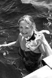 潜航的女孩 免版税库存图片