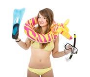 潜水和海滩一名妇女的比基尼泳装的 库存照片