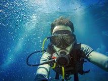潜水者画象在海 免版税图库摄影