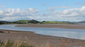 潮汐出海口英国Cumbria 免版税库存图片