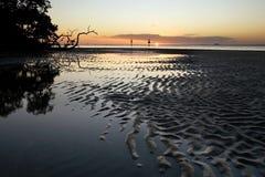 潮汐平面的日落 库存图片