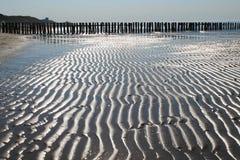 潮汐的沙子 库存图片