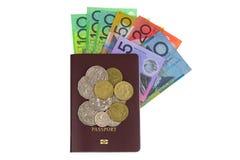 澳大利亚元钞票AUD和硬币在被隔绝的护照 免版税库存图片