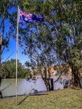 澳大利亚旗子在灌木骄傲地飞行 免版税图库摄影