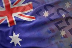澳大利亚的五颜六色的挥动的国旗欧元金钱钞票背景的 库存图片