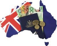 澳大利亚的地图有旗子、现金和护照的旅行概念的 免版税库存图片