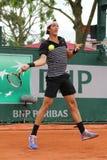 澳大利亚的职业网球球员Thanasi Kokkinakis在第二次回合比赛期间的在罗兰・加洛斯 库存照片