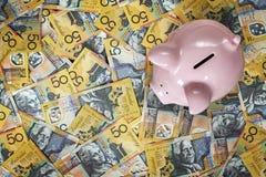 澳大利亚金钱顶视图的存钱罐 免版税库存图片