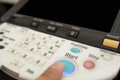 激光影印机的关键董事会按钮 库存图片