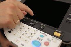 激光影印机的关键董事会按钮 免版税库存图片