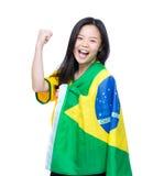 激动的亚洲妇女装饰与巴西旗子 库存图片