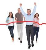 激动的商人在竞选中获胜 免版税图库摄影