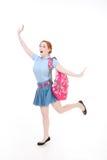 激动的高中青少年的女小学生或大学生有后面的 库存照片