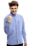 激动的年轻人紧握拳头 库存图片
