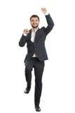 激动的年轻商人跳舞 免版税库存图片