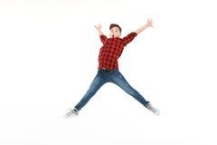 激动青少年在跃迁 免版税库存图片