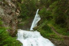 瀑布在意大利阿尔卑斯 库存照片