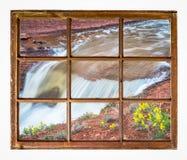 瀑布有野花窗口视图 免版税图库摄影