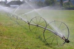 灌溉线路系统轮子 库存图片