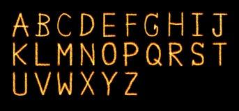 火信件 信件和标志在火-在A-Z上写字 库存图片