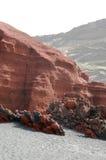 火山岩形成和黑沙子 库存图片