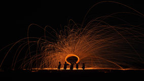 火旋转做了一个摩托车阴影 免版税库存照片