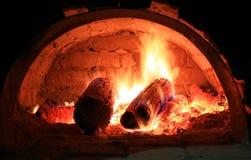 火火焰在烤箱的 免版税库存图片